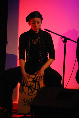 Judy Koot playing the cajón